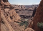 Lower portion of the Hole-in-the-Rock crevice prior to Lake Powell. The river was crossed on a ferry constructed and operated by Charles Hall. Lamont Crabtree Photo